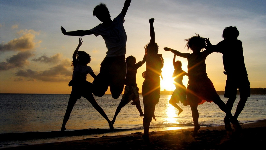 dancing-on-the-beach-in-summer